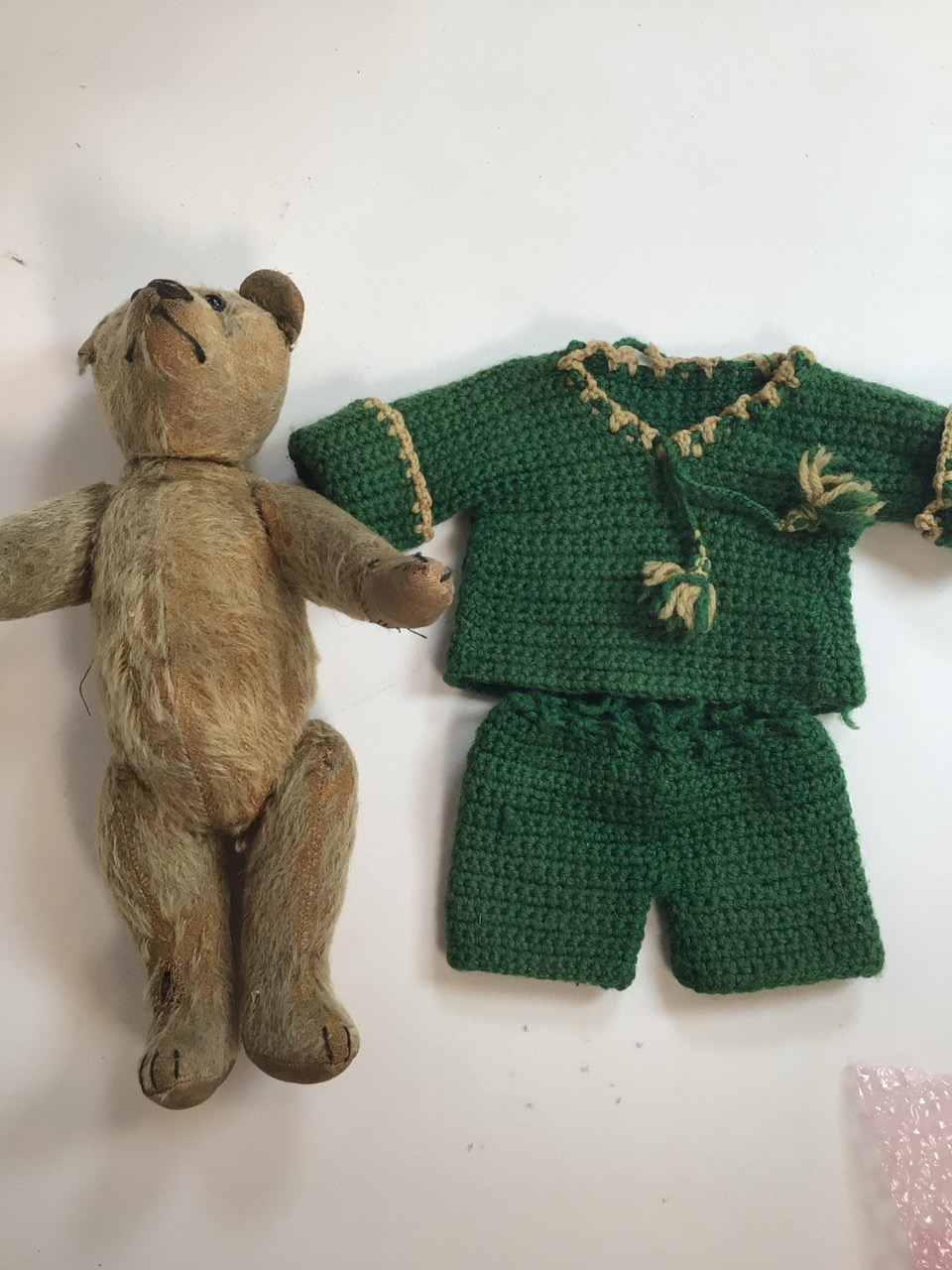 An early 1900s, assumed to be, Stieff bear with original shoe black button eyes and hump back. H: