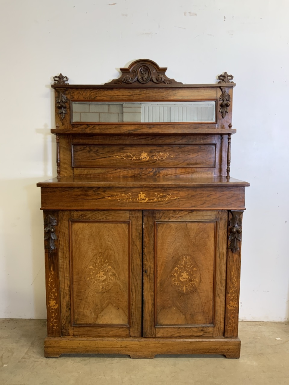 An inlaid walnut credenza with large double cupboard doors with interior shelf. With original mirror