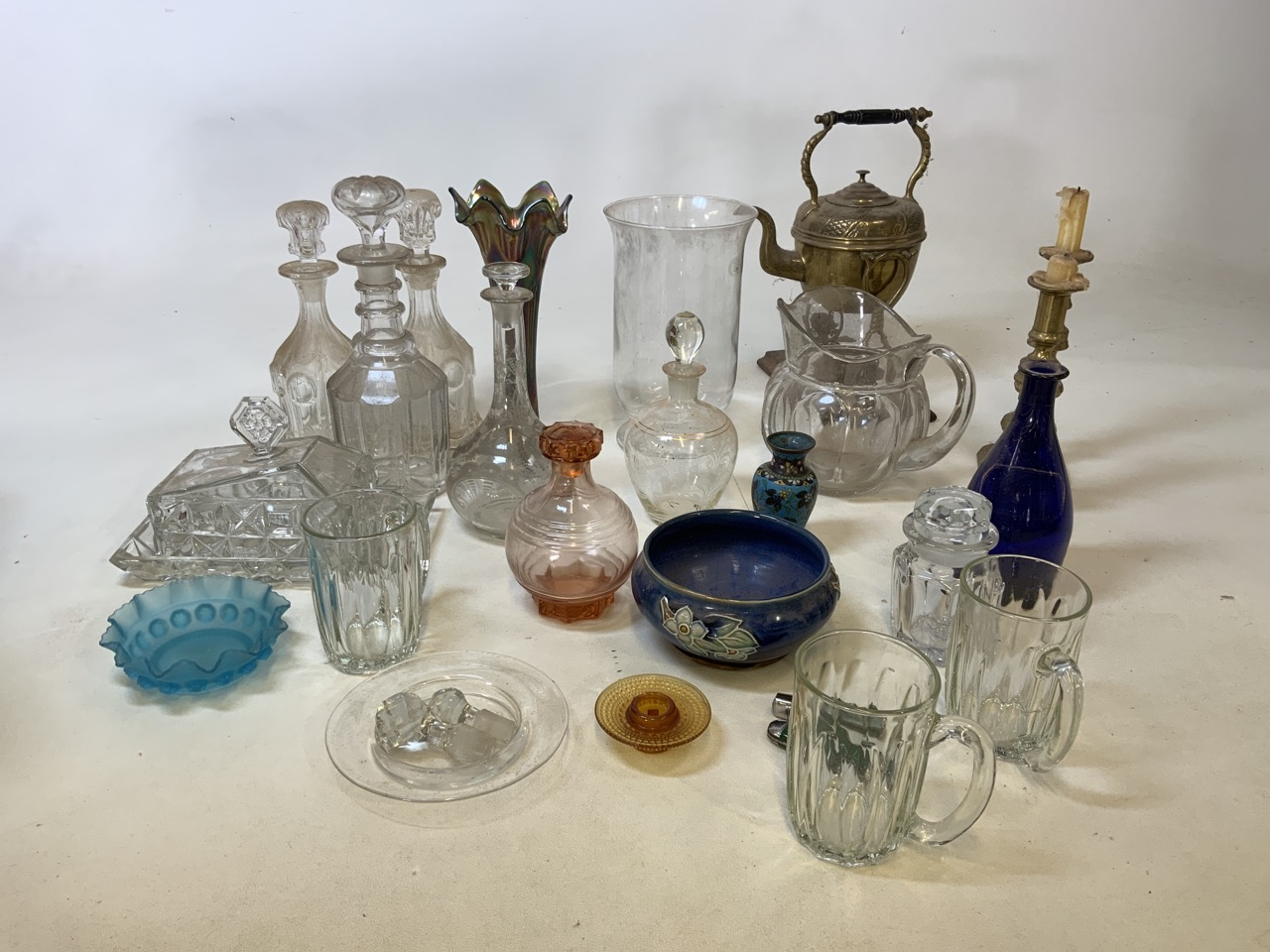 A mixed collection of glass, metal wear and ceramics. To include a brass kettle and a pair of