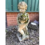 A reconstituted stone statue of a young girl carrying a post of flowers. Previous repair to neck see