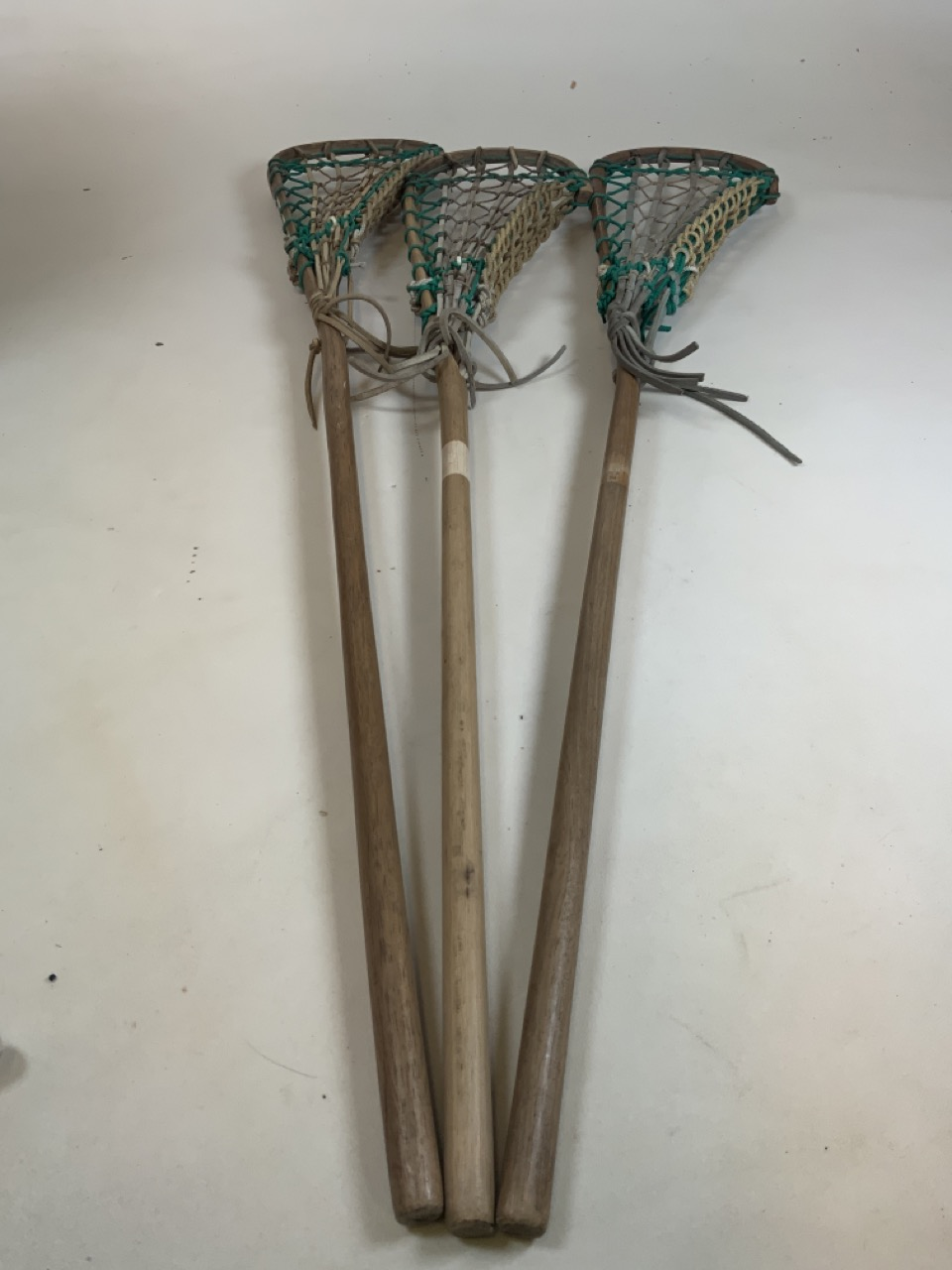 Three lacrosse sticks, tow with Hattersleys labels . Longest stick 110cm
