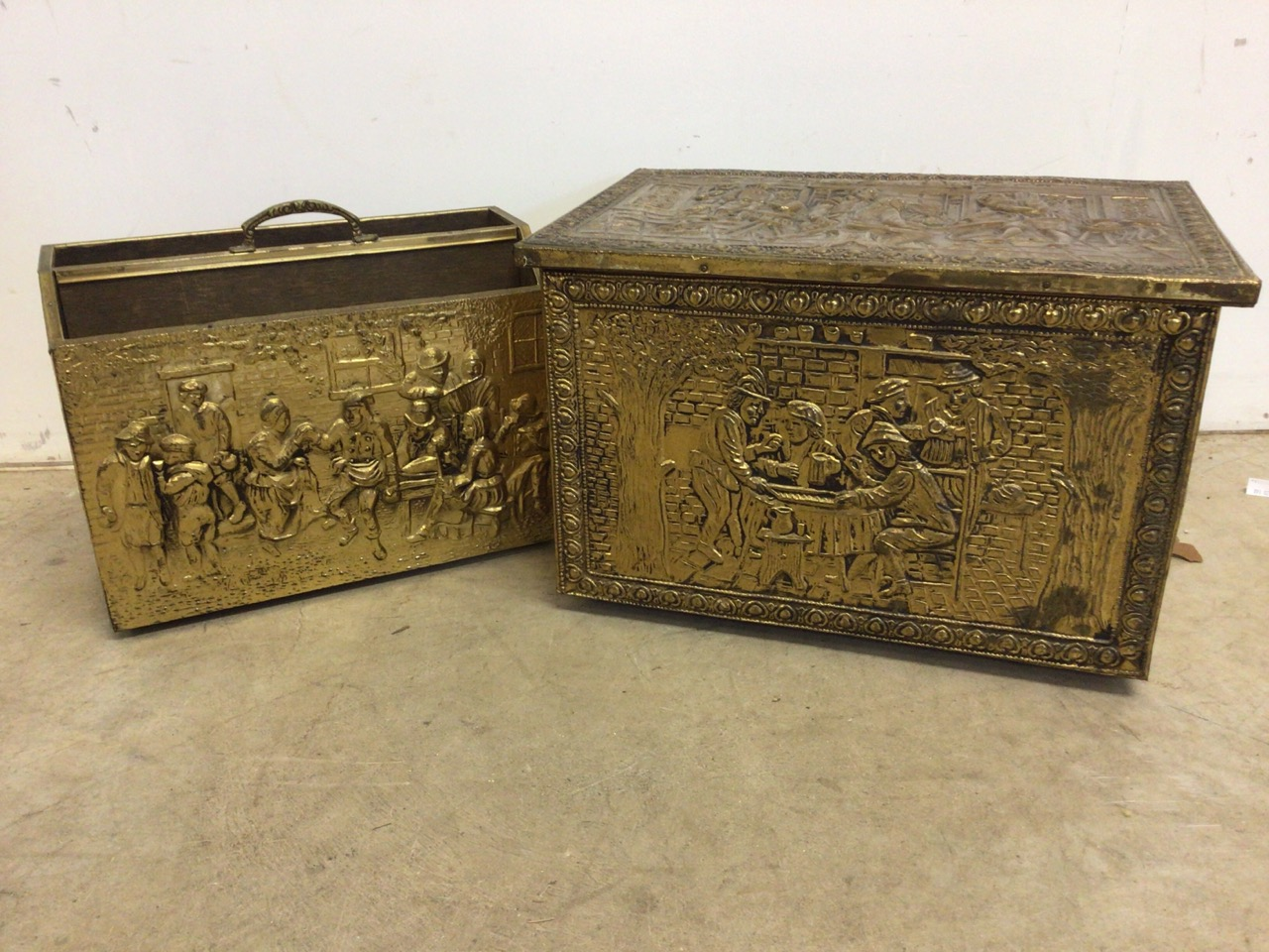A brass coal box also with a magazine rack with images of pre lockdown action packed pub scenes.