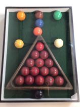 Snooker balls and triangle in a presentation case. W:40cm x D:7cm x H:52cm