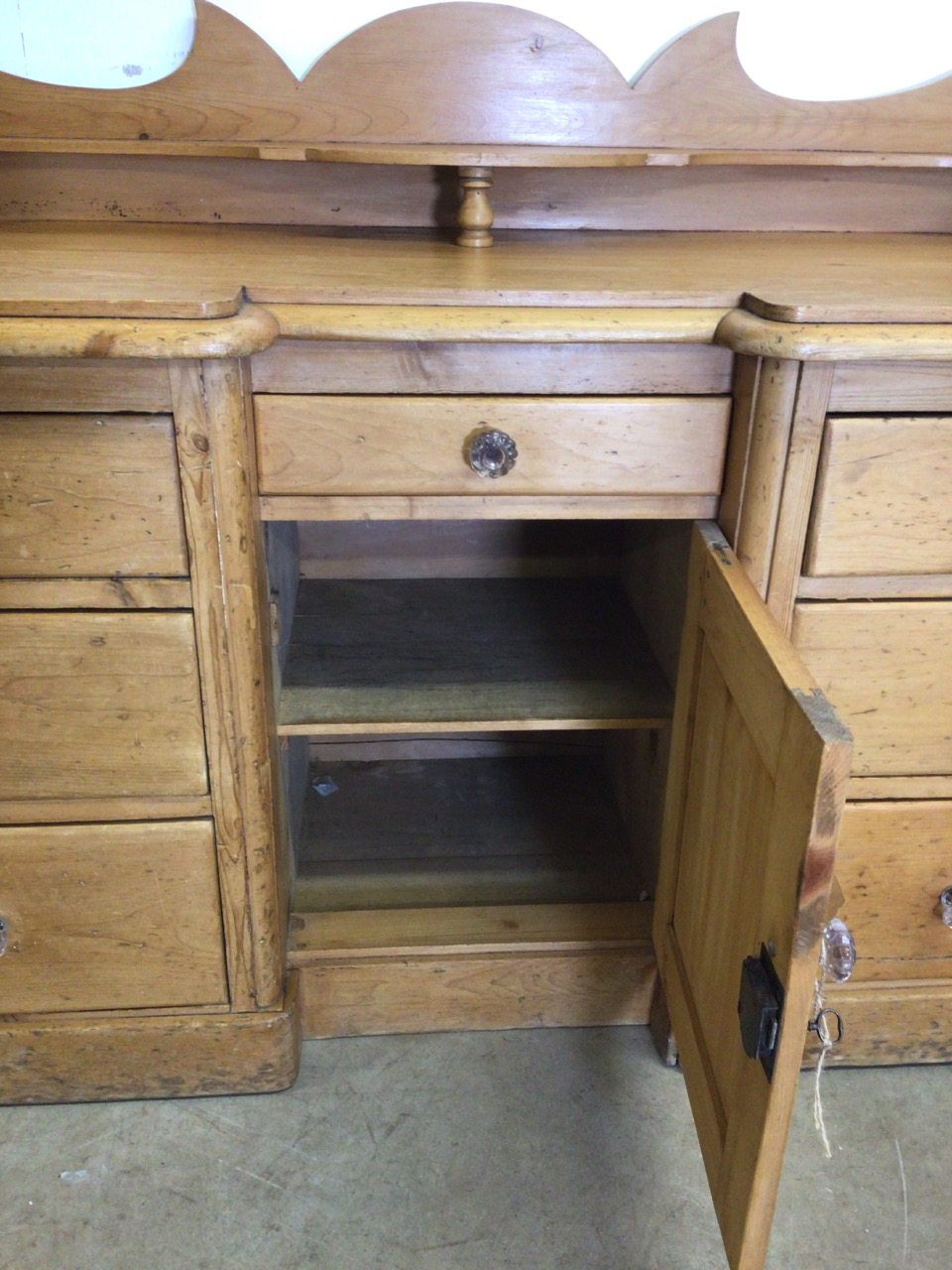 A large Victorian pine desk cabinet with central cupboard with drawer above, flanked by two banks of - Image 4 of 7