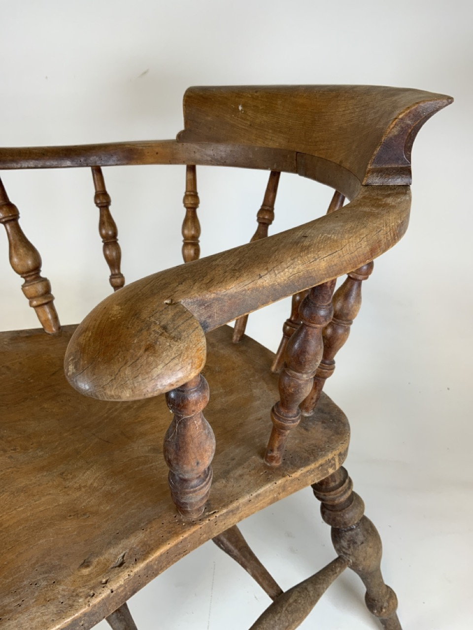 A Victorian smokers bow arm chair with curved top rail and turned spindles with saddle shaped seat - Image 4 of 10