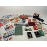 A collection of stamps and vintage playing cards - many unused
