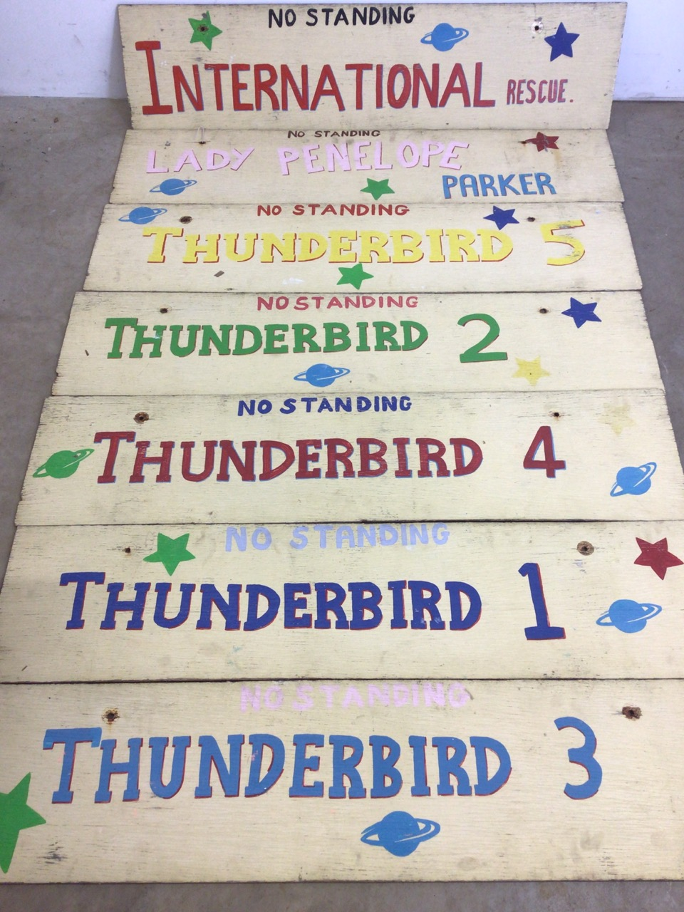 Seven Thunderbirds hand painted signs on wooden boards. W:129cm x H:30cm