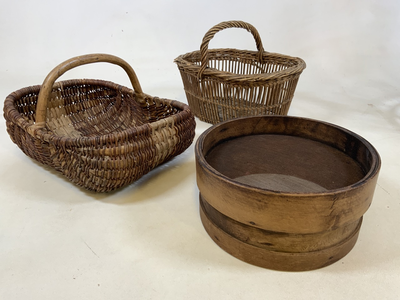 Two vintage french baskets together with a wooden sieve .Sieve W: 27cm x H: 13cm.