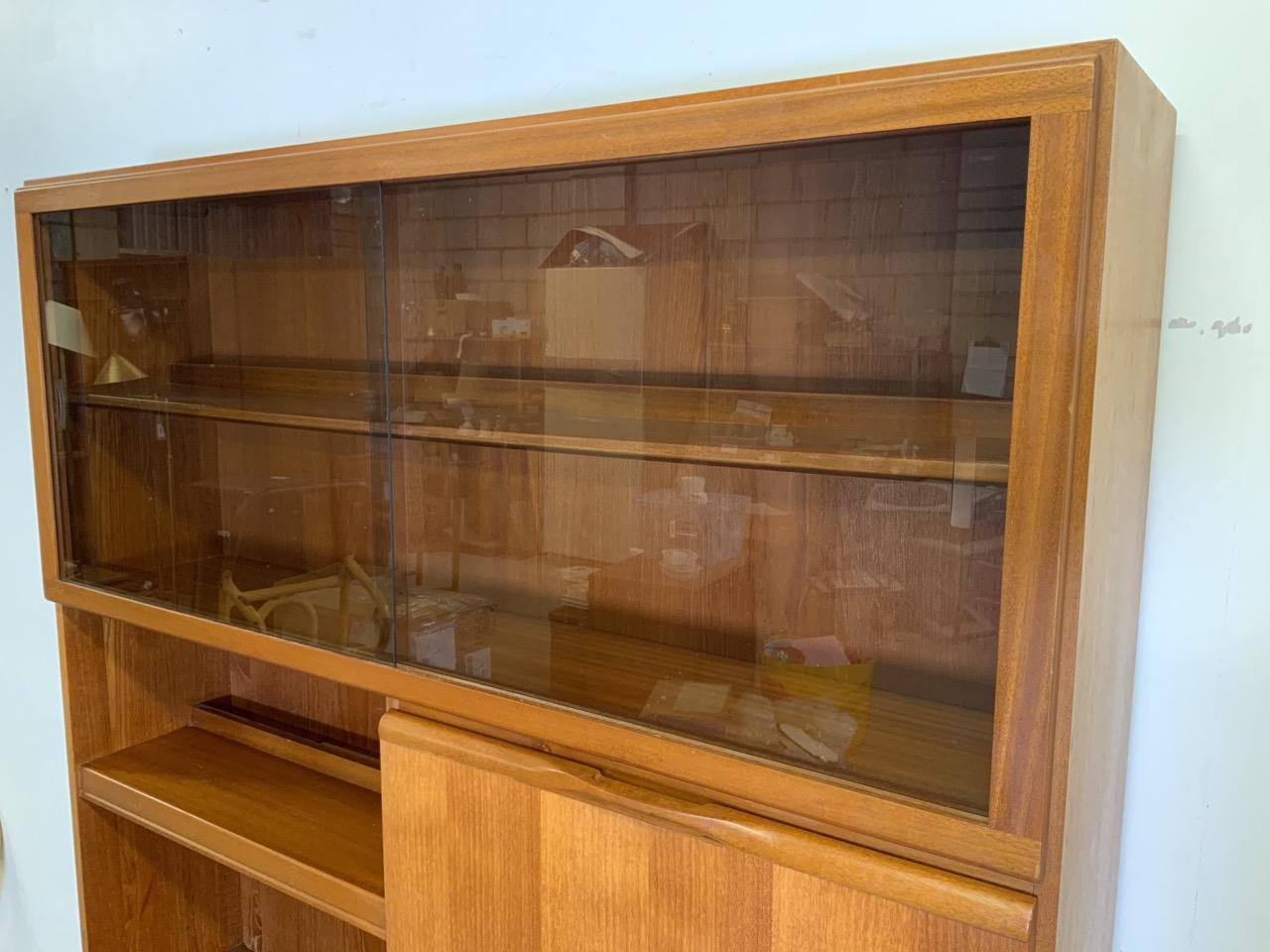 A McIntosh teak mid century two piece glazed wall unit, with smoked glass sliding doors to shelf - Image 5 of 10