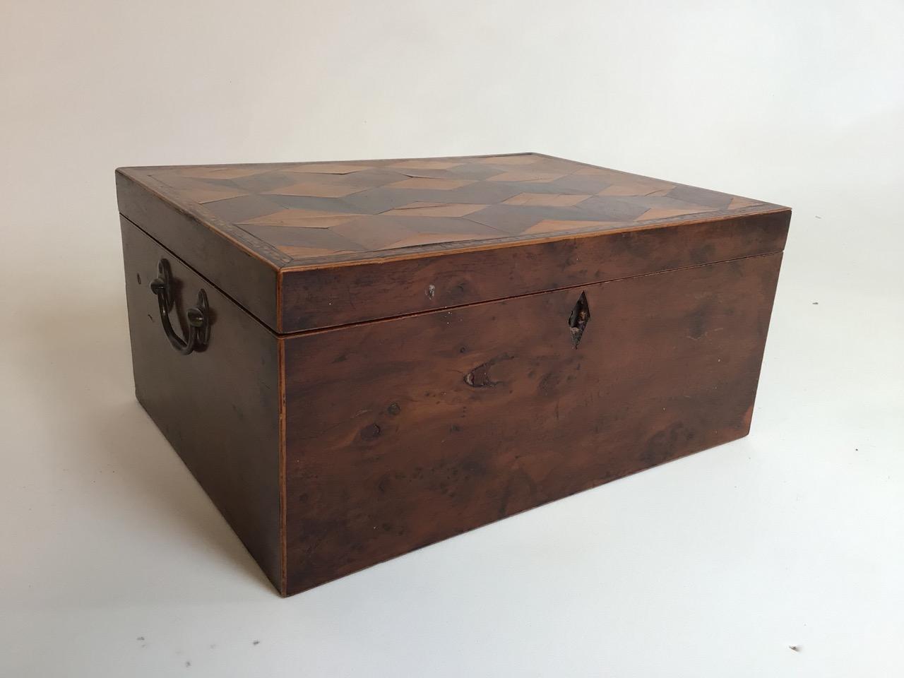 A Victorian parquetry walnut box with metal handles. W:33cm x D:24cm x H:15cm