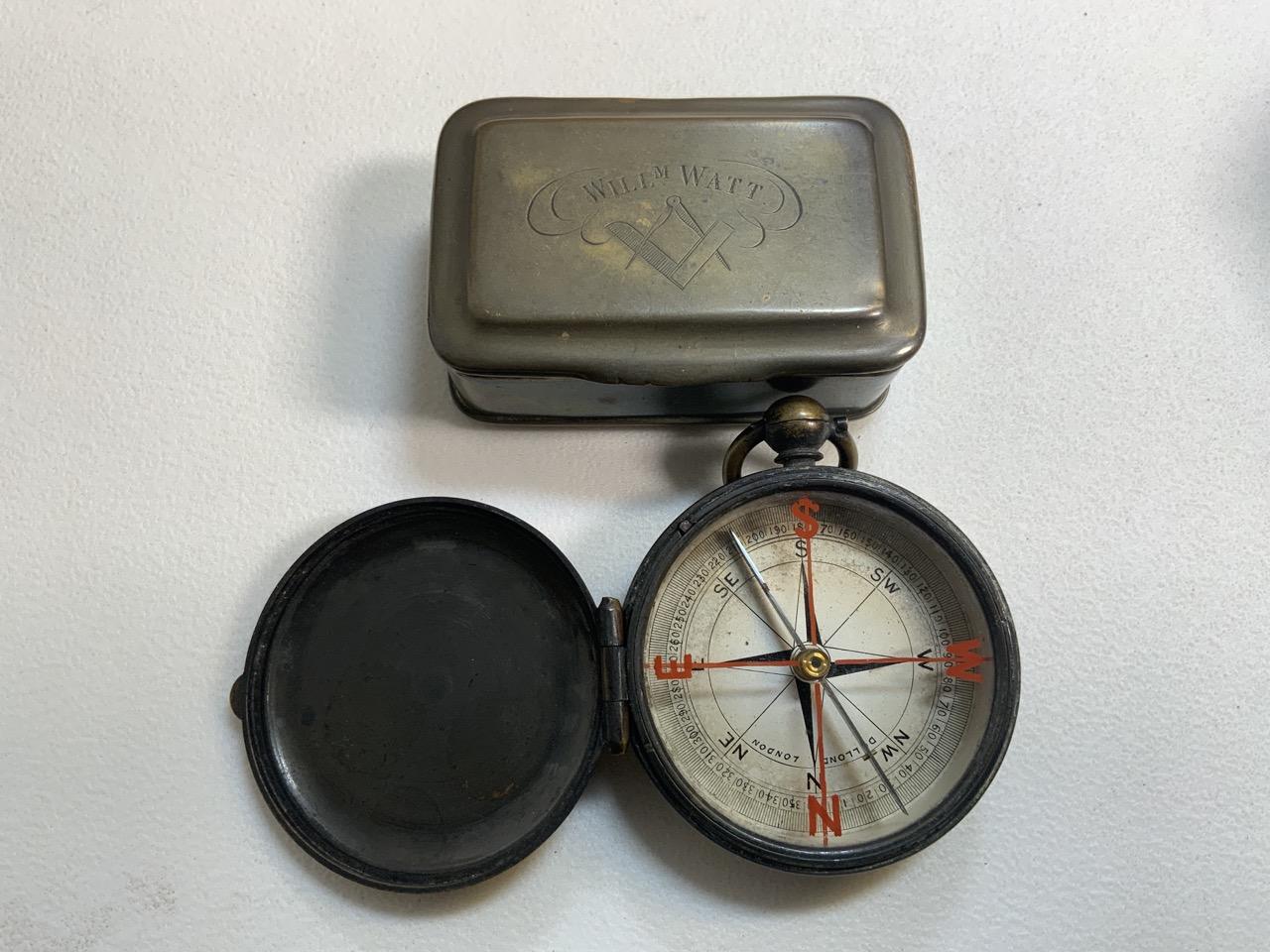 A Victorian brass pocket compass also with a brass snuff box.