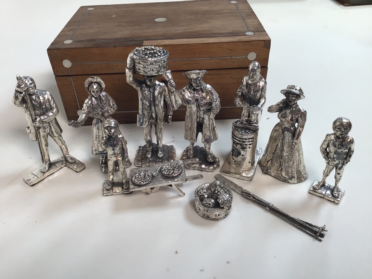 Eleven silvered figures and a wooden box with mother of pearl inlay. - Image 2 of 4