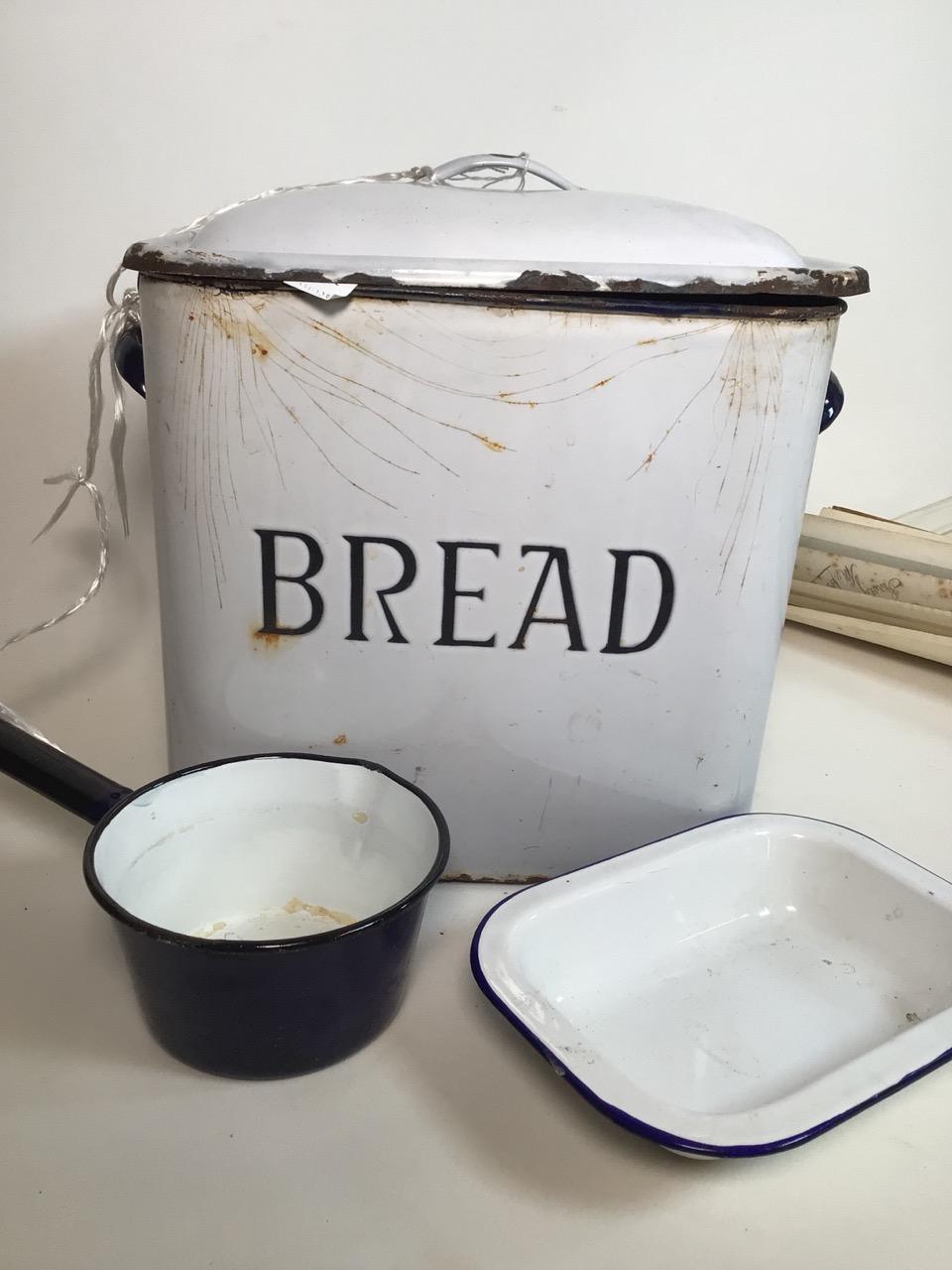 An enamel bread bin, a pan and dish. W:35cm x D:23cm x H:34cm