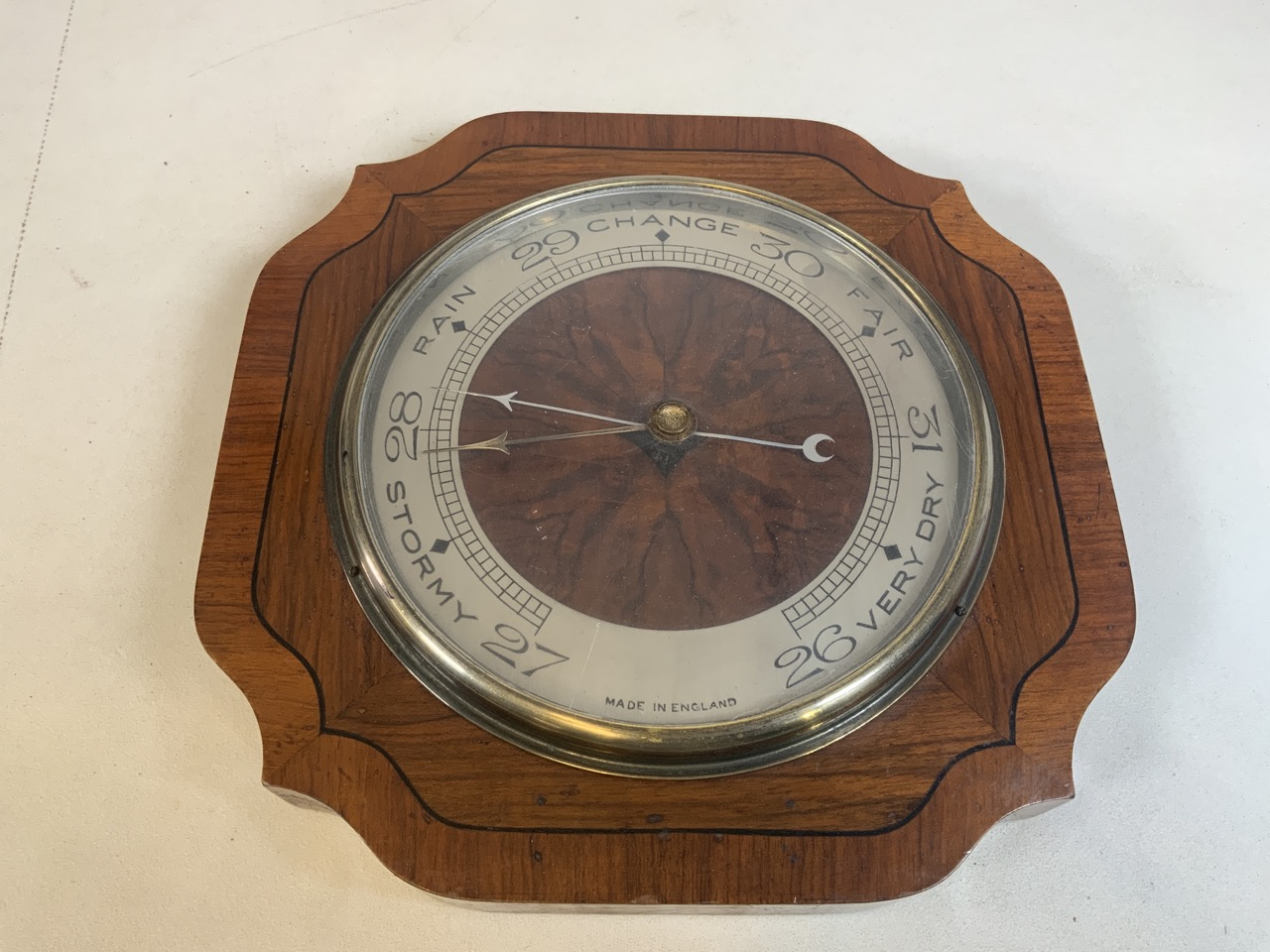 A wooden wall barometer with presentation plaque on reverse dated 1933 W:30cm x D:4.5cm x H:30cm