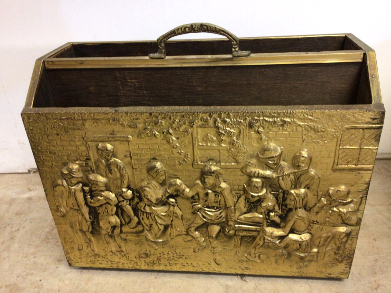 A brass coal box also with a magazine rack with images of pre lockdown action packed pub scenes. - Image 3 of 4