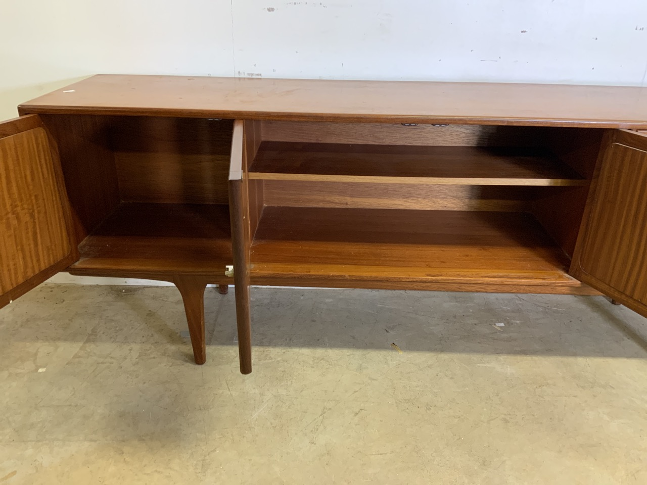 A mid century C.1960s teak sideboard by John Herbert for A Younger. Double cupboard doors to - Image 6 of 10