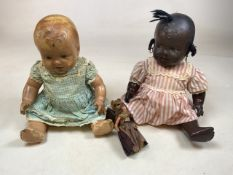 Two mid century composition dolls with a miniature doll together with a china dolls tea set