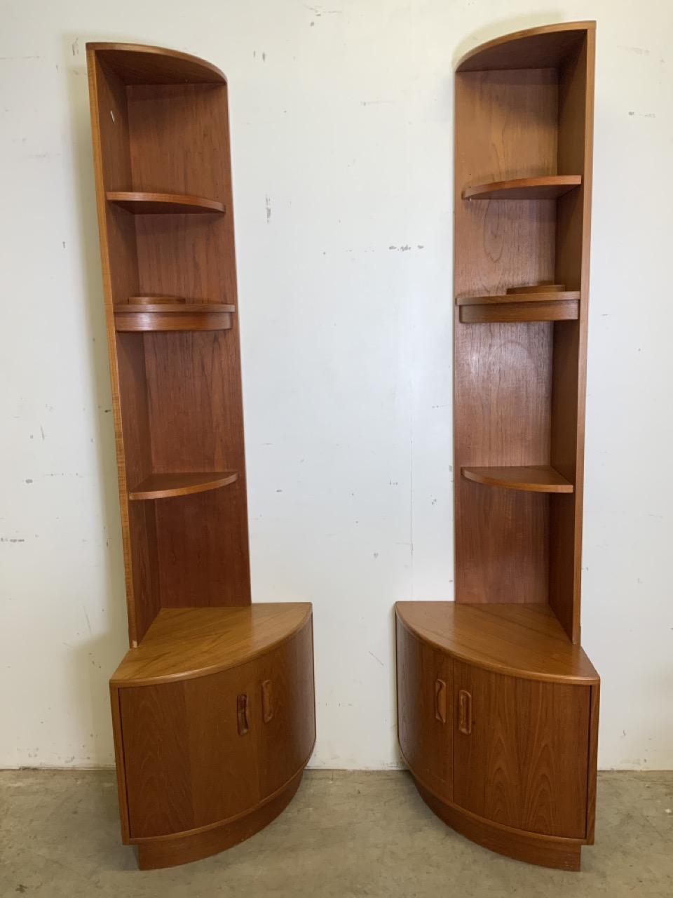 A pair of teak mid century G Plan two piece corner shelves with cupboards below. W:46cm x D:46cm x