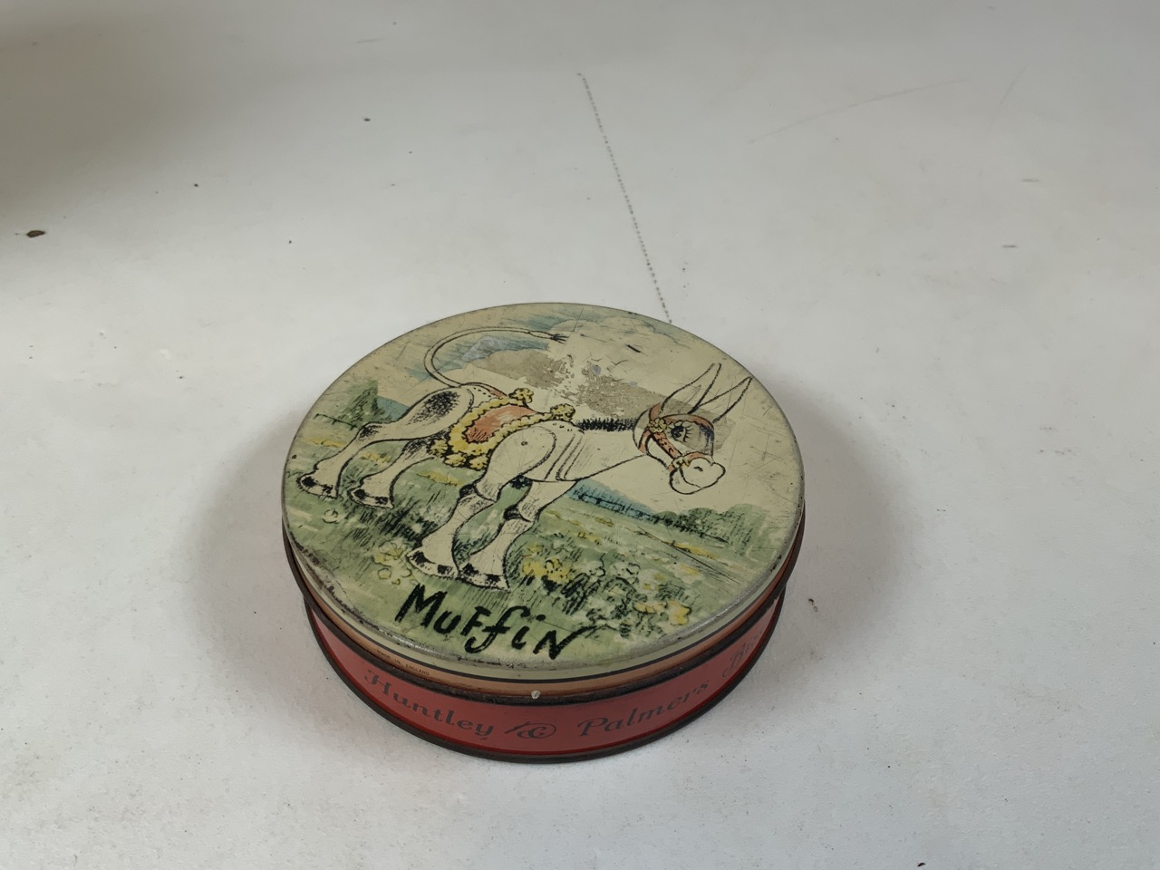 An enamel flour storage tin together with a Huntley and Palmer Muffin the Mule tin, a William - Image 7 of 7