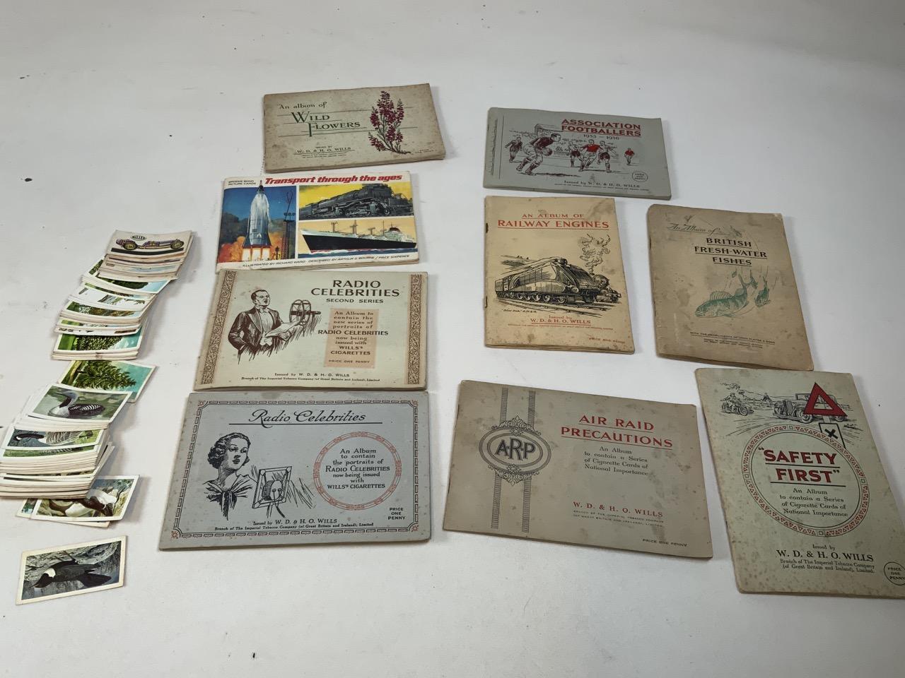 Nine cigarette card albums including Association footballers 1935-1936, Radio celebrities, An