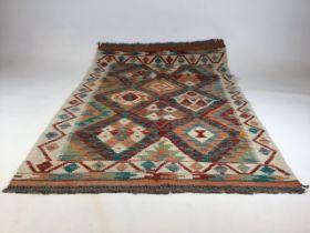 A Chobi Kilim rug. W:86cm x H:122cm