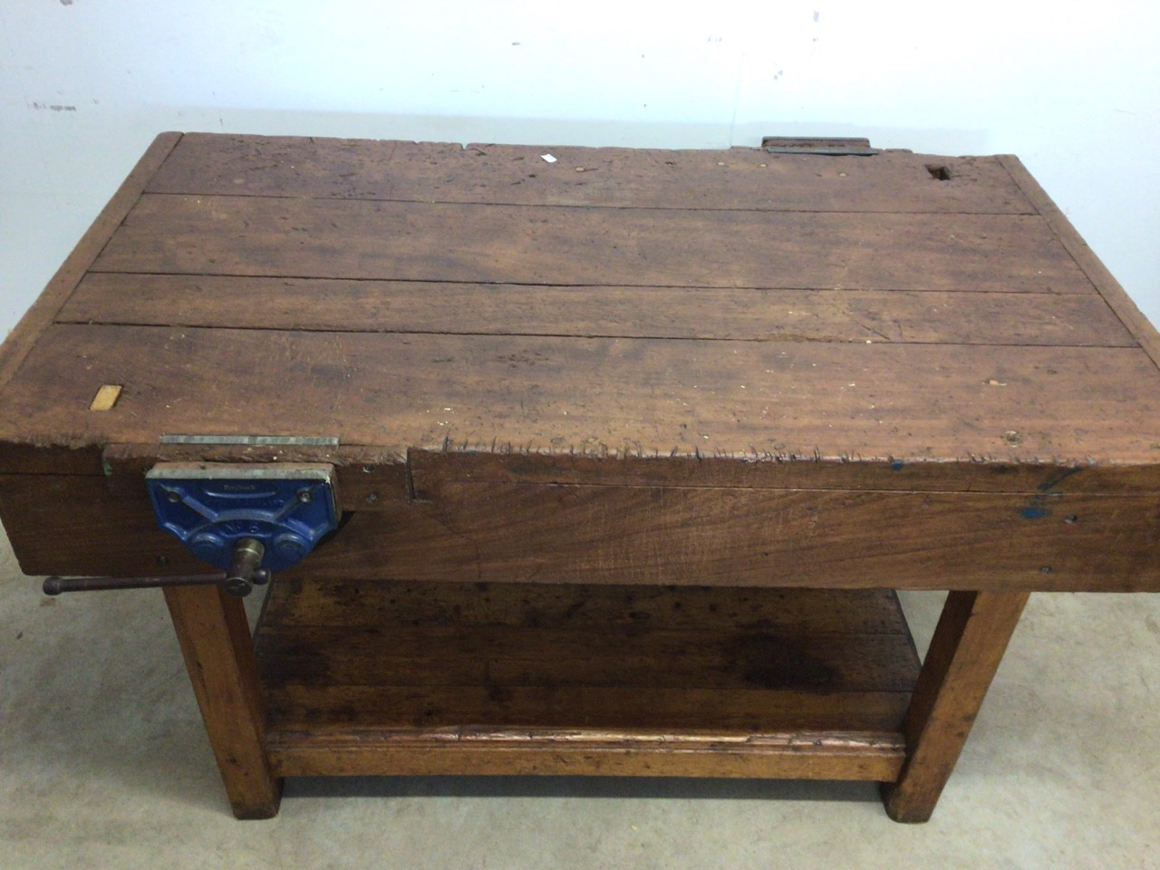 An antique Hardwood workbench with two vices and a lower shelf. W:140cm x D:85cm x H:78cm