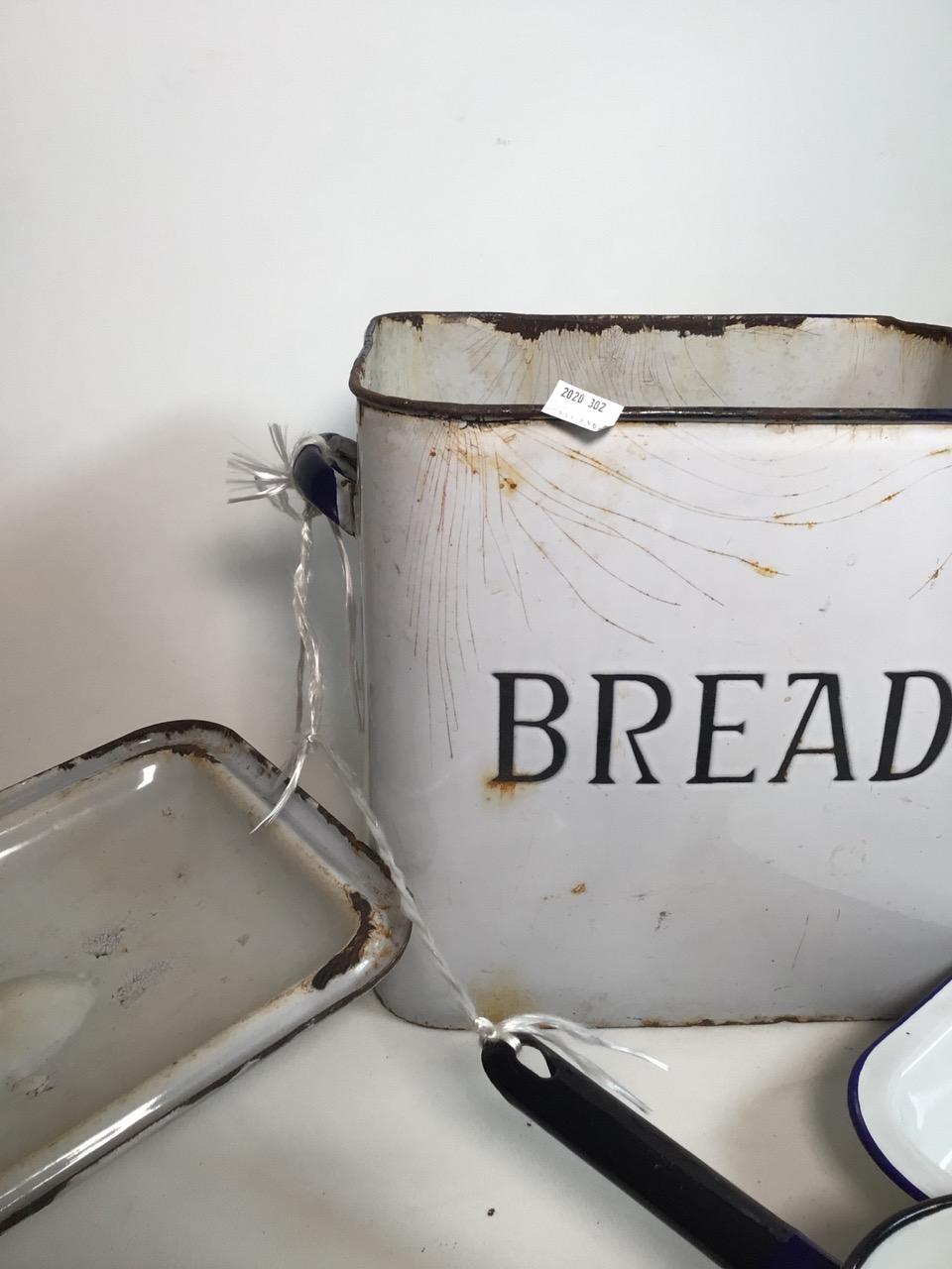 An enamel bread bin, a pan and dish. W:35cm x D:23cm x H:34cm - Image 2 of 4