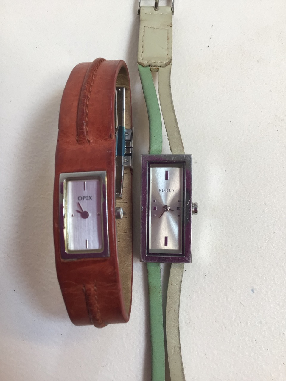 Two ladies watches, Opex and Furla with leather strap.