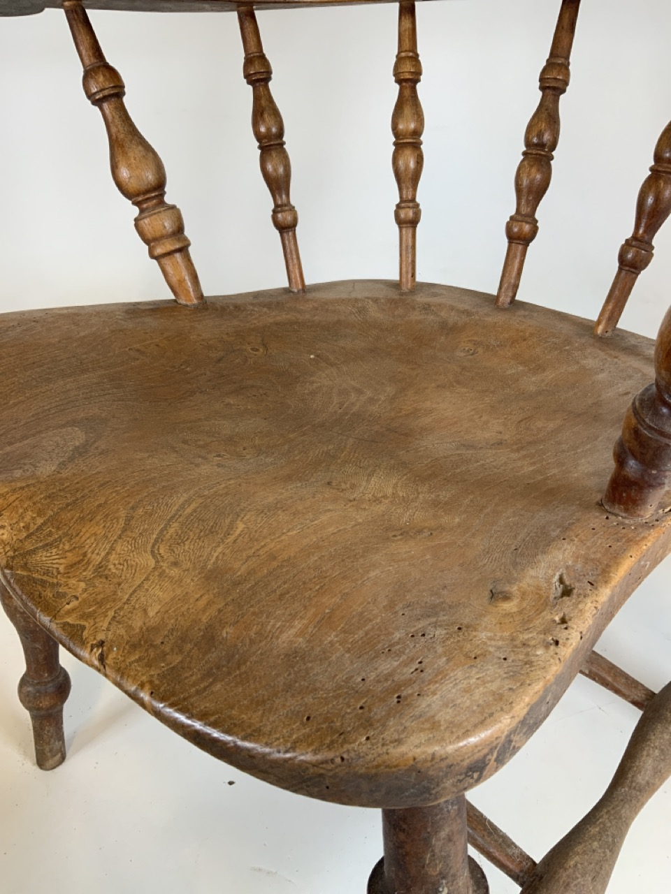 A Victorian smokers bow arm chair with curved top rail and turned spindles with saddle shaped seat - Image 5 of 10