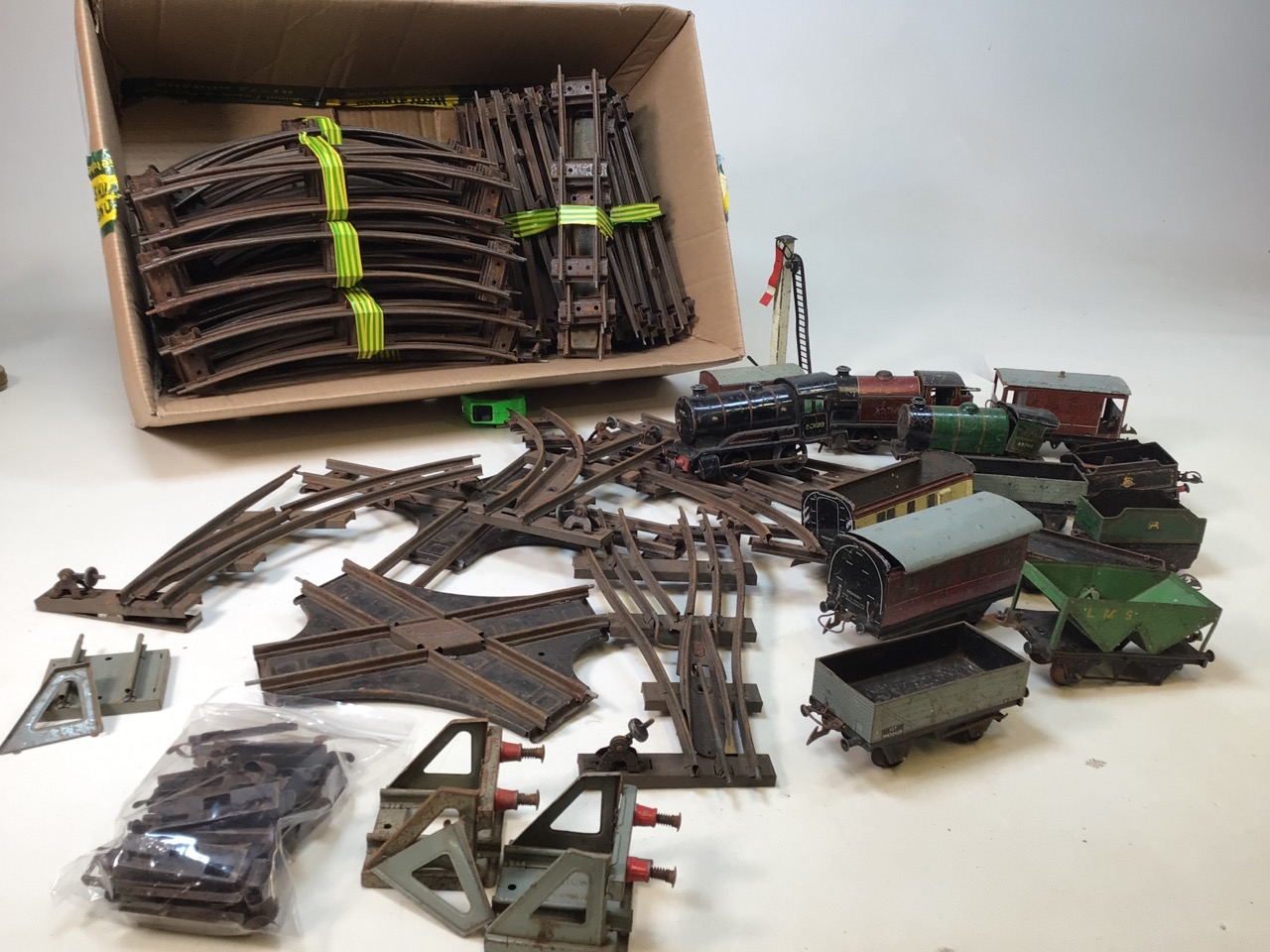 A large collection of 0 gauge Hornby tinplate items to include track, track accessories, buffers,