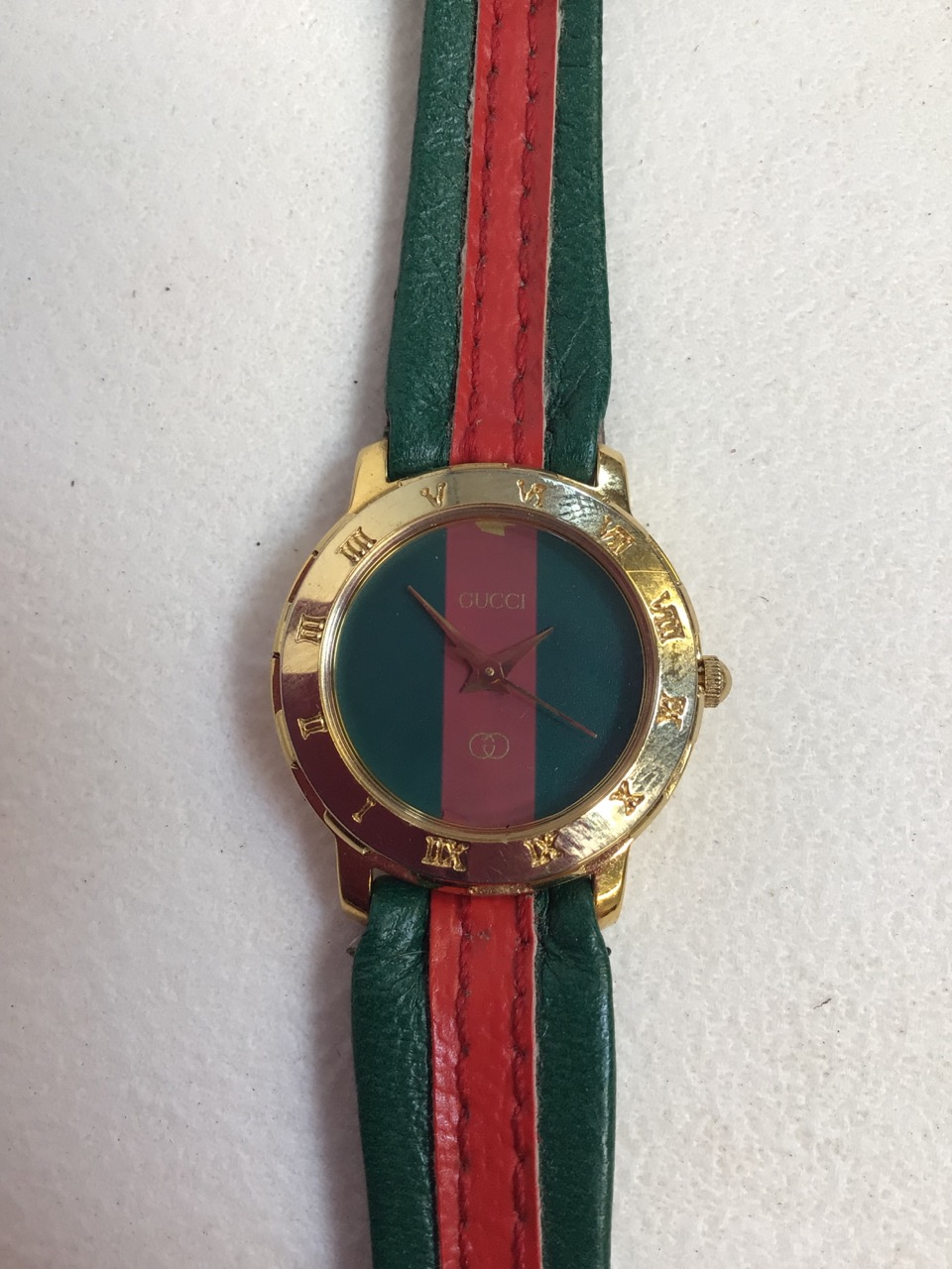 A ladies watch stamped Gucci.