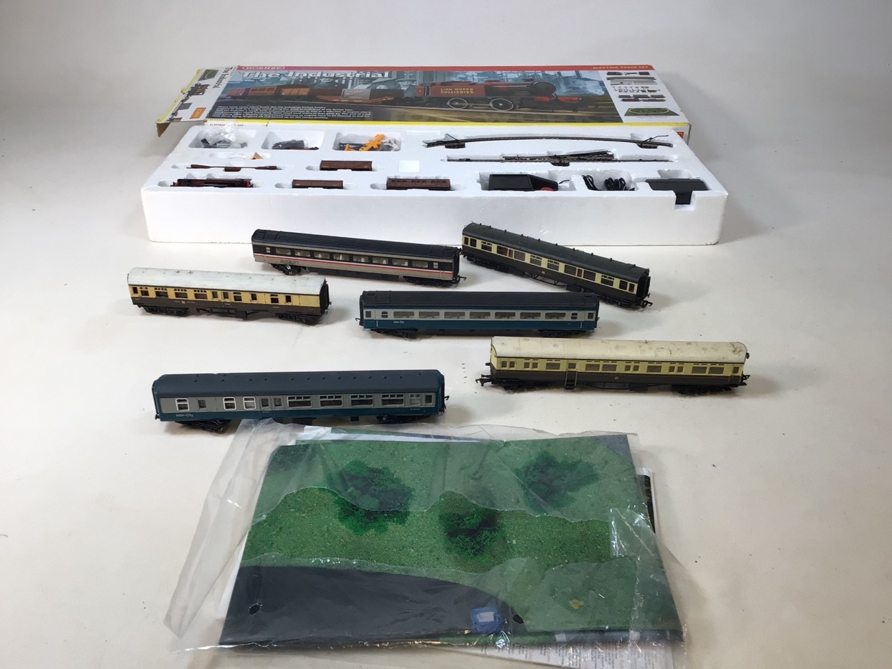 A Hornby Industrial Set (boxed) and unused with six extra carriages (used) 00 gauge.