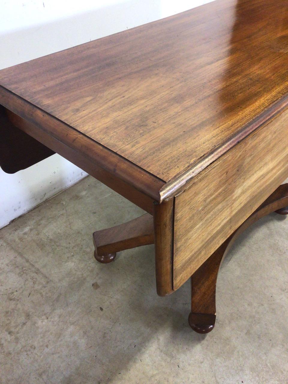 A Victorian Pembroke table with drop leaf sides, pedestal base with turned feet on metal castors. - Image 4 of 6