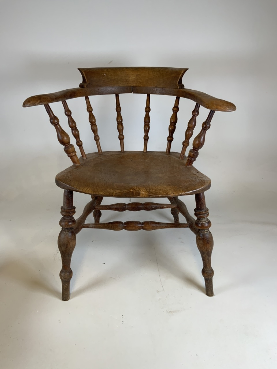 A Victorian smokers bow arm chair with curved top rail and turned spindles with saddle shaped seat - Image 2 of 10