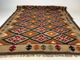 A Maimana Kilim wool rug. W:127cm and H:202cm