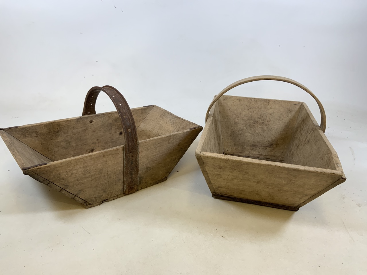 Two vintage French wooden flower trugs. One with bentwood handle and one with metal handle W:36cm