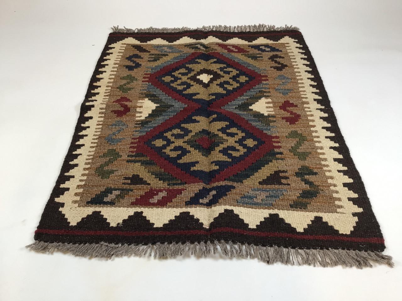 A Maimana Kilim rug. W:69cm x H:77cm