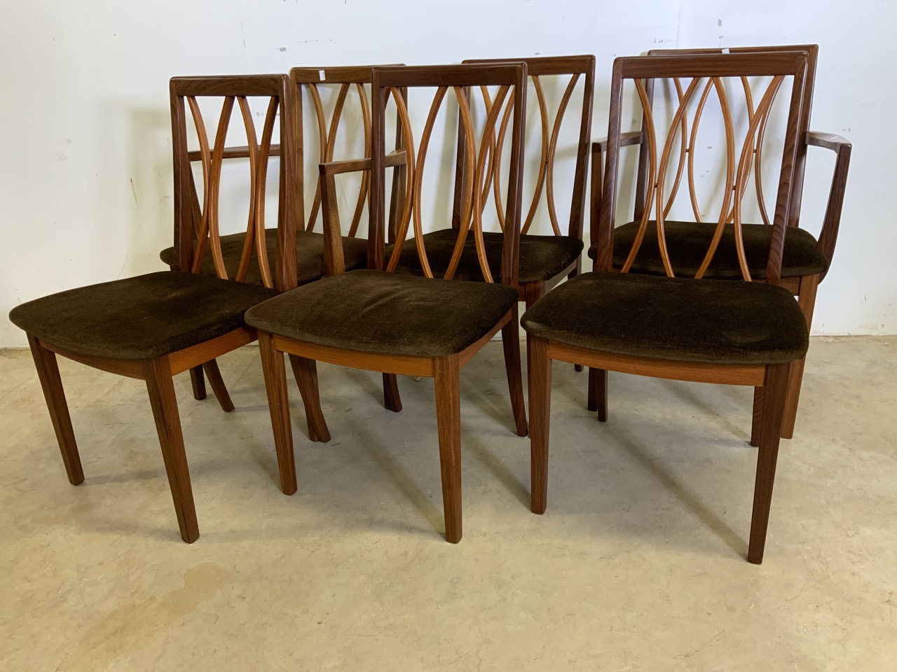 A set of six Fresco G Plan E Gomme limited teak and rosewood chairs to include two carvers. With