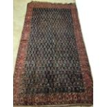 A vintage Persian Bihar rug with navy blue ground and terracotta borders. W:310cm x H:170cm