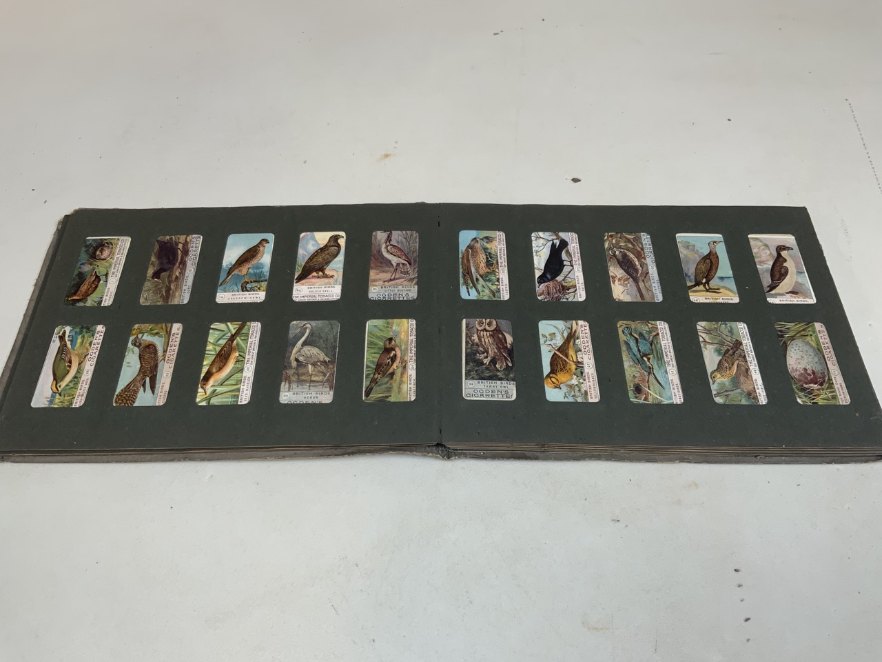 An album of cigarette cards, a collection of Beatrix Potter book A/F, a tobacco tin with glass vials - Image 12 of 14