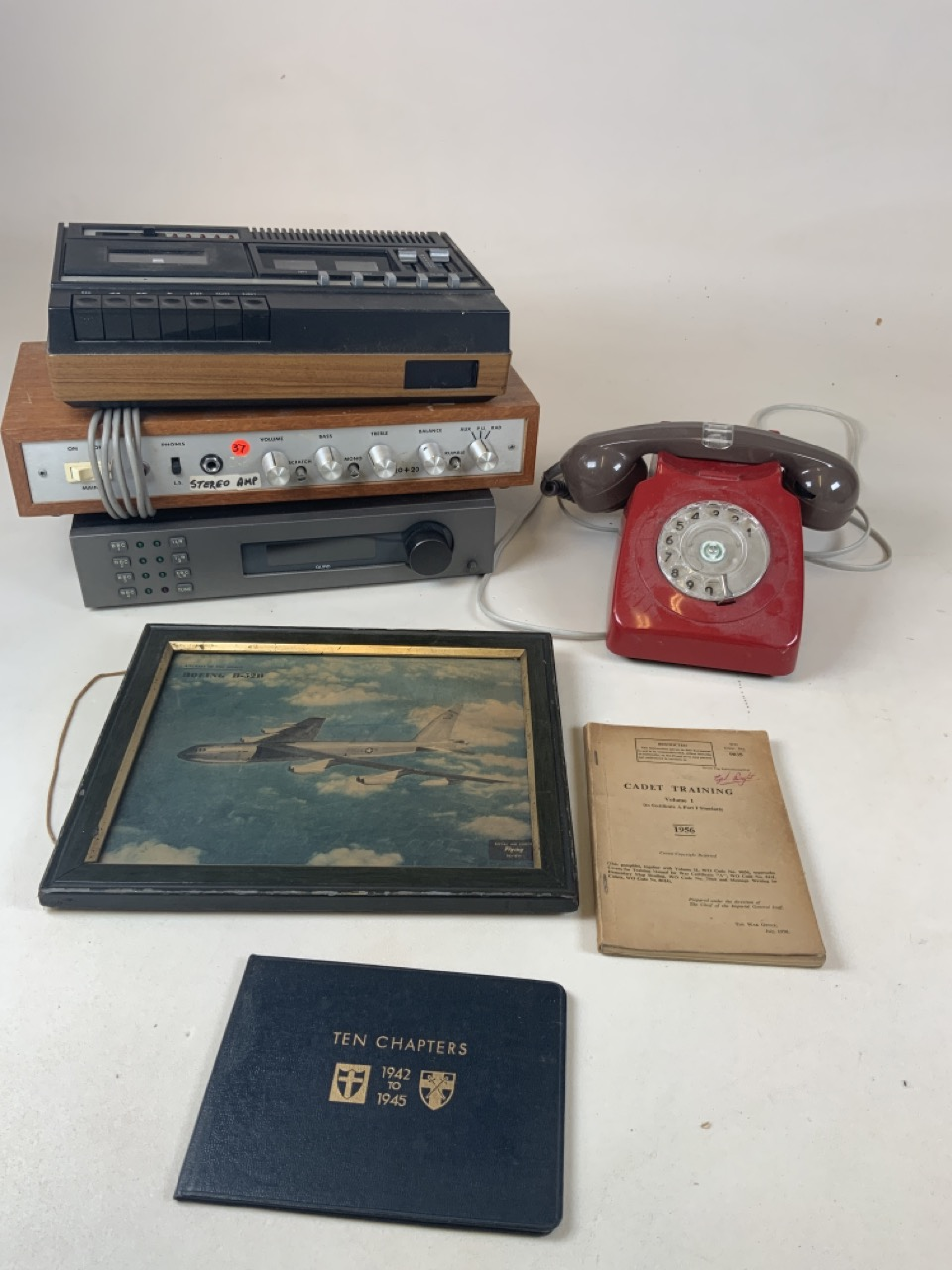 A vintage red phone together with a framed probing of Boeing B-52B, a Cadet Manuel 1956, Ten