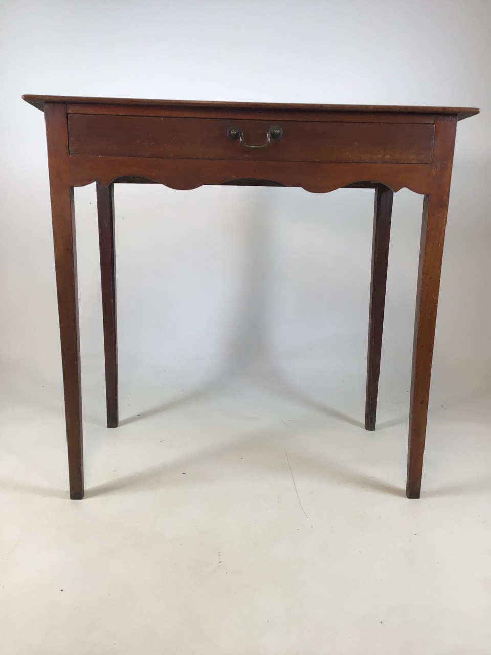 Small antique Georgian style side table with tapered legs with large central drawers and brass