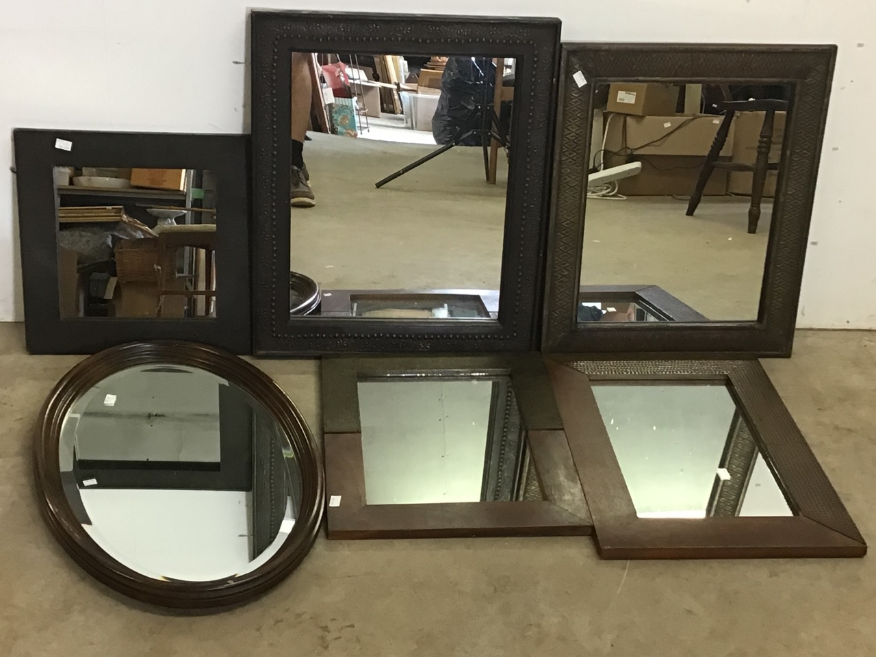 Six modern mirrors including an oval bevelled mirror. W:40cm x H:50cm