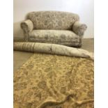 A modern drop end sofa on brass castors also with a roll of material. W:165cm x D:97cm x H:76cm