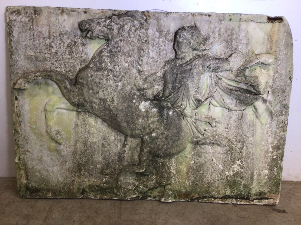 A large moulded relief panel of the Elgin marbles on plaster and fibre. W:143cm x H:101cm