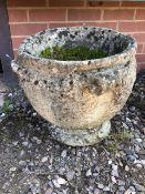 A large circular reconstituted stone planter. W:48cm x D:48cm x H:43cm