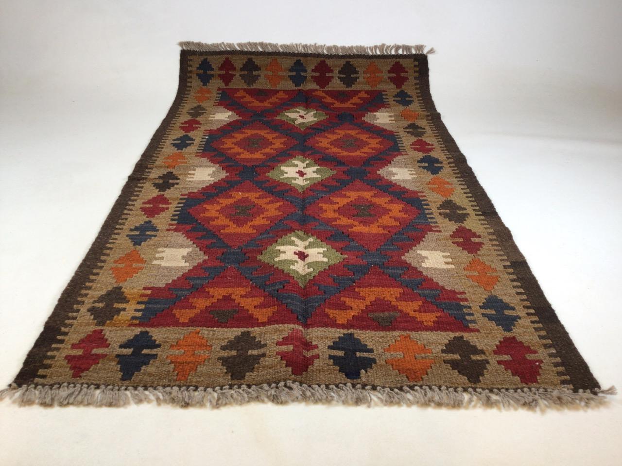 A Maimana Kilim rug. W:78cm x H:132cm
