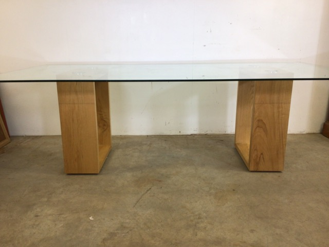 A large modern Abbas glass table with oak supports. W:240cm x D:120cm x H:76cm