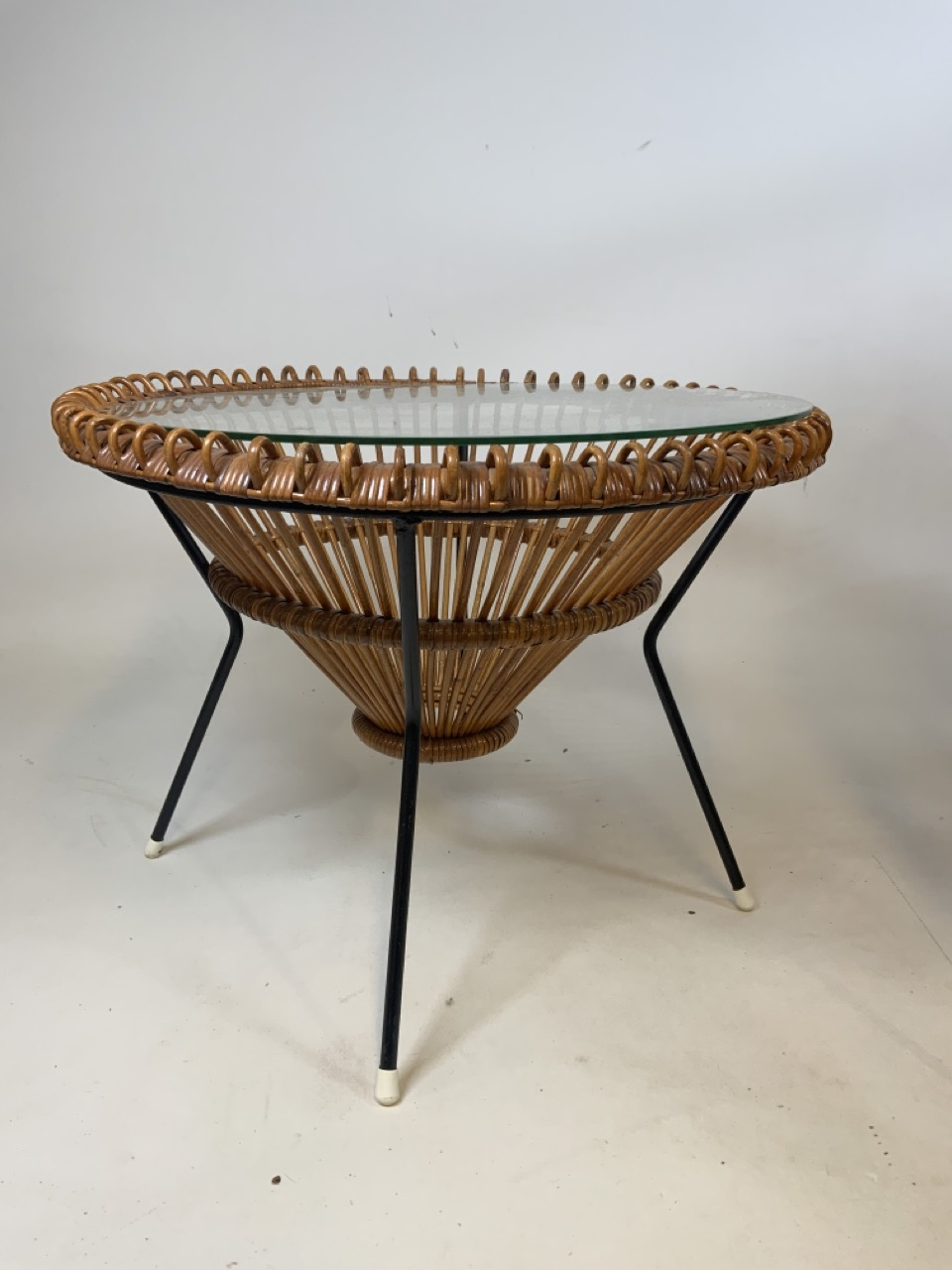 A Franco Albini mid century circular coffee table in wicker and metal with glass top and two - Image 5 of 7