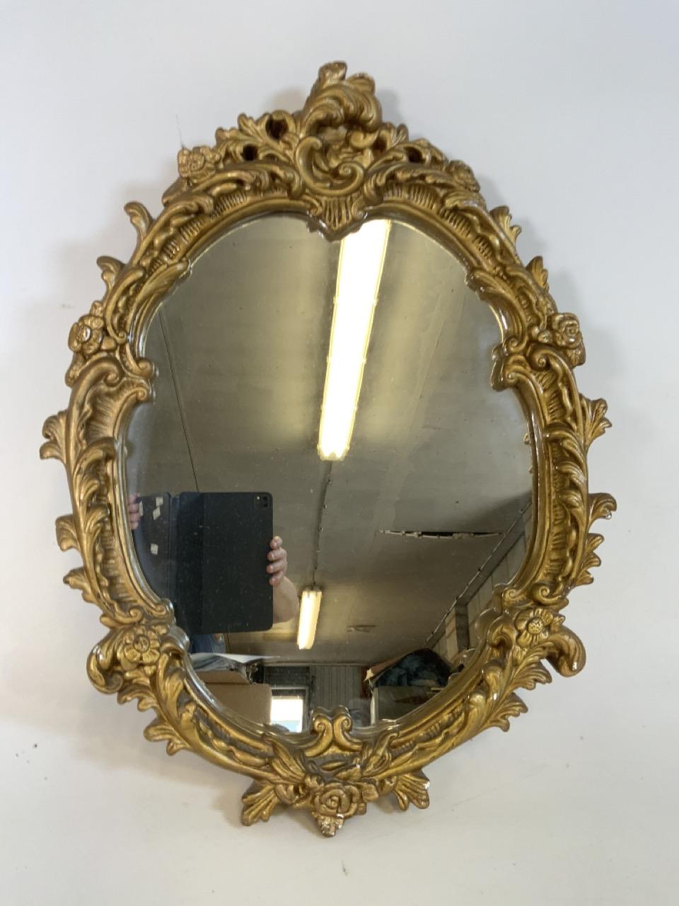A gilt framed oval Rocco style mirror . W:51cm x H:64cm - Image 2 of 3